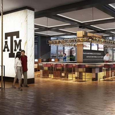 indoor bar with large texas a&m sign