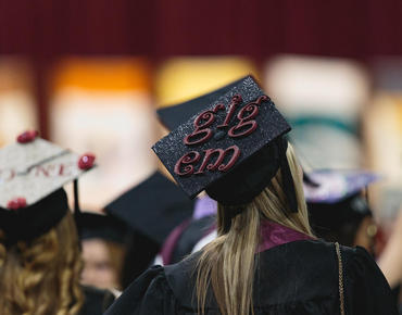 woman wearing a hat at graduation