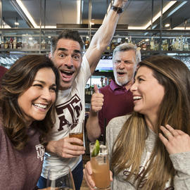 people celebrating at texas a&m bar