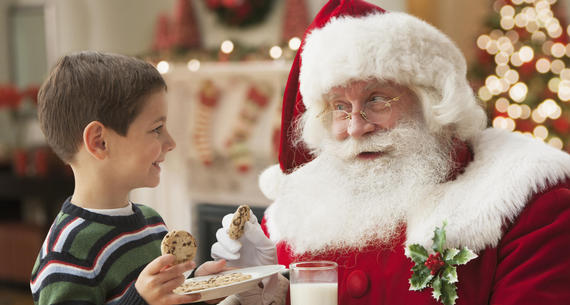 boy and santa with cookies