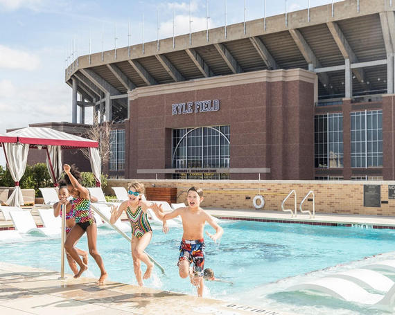 outdoor pool with texas a&m logo in the bottom