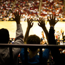 fans cheering at a basketball game