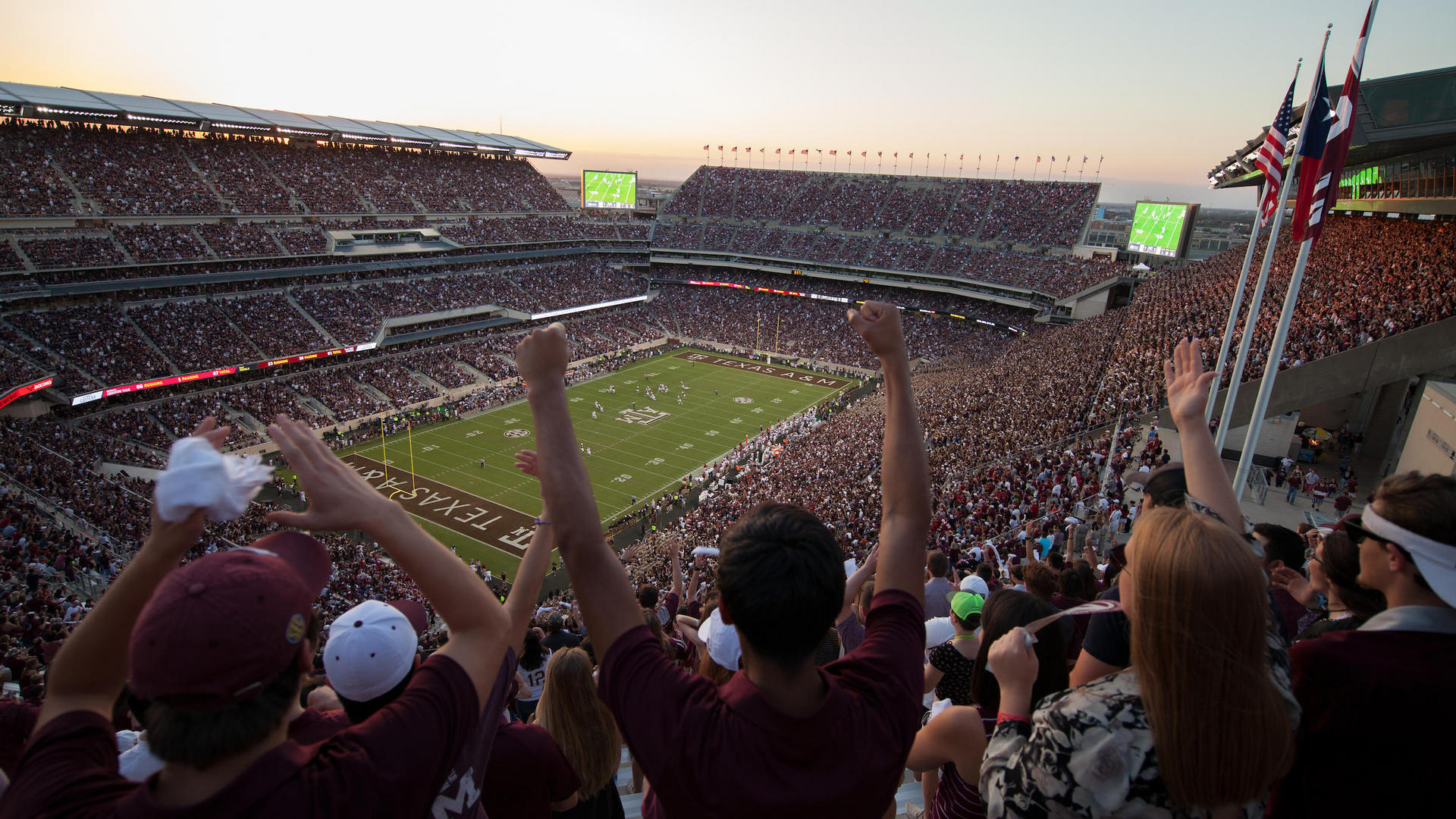 people cheering at kyle field on gameday